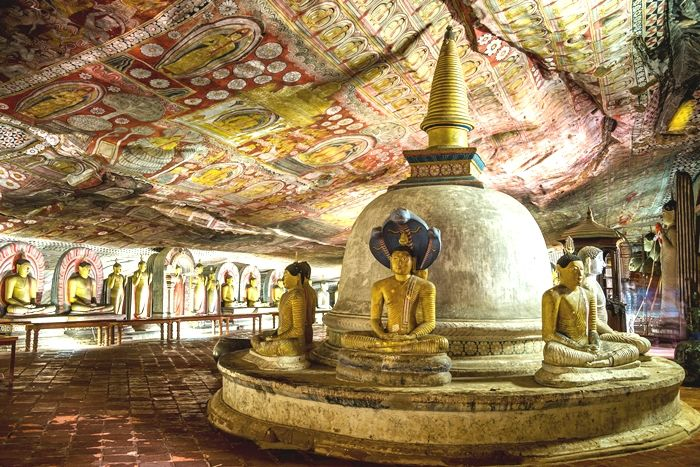 ancient artworks ans statues inside dambulla cave temple